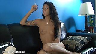 Tattooed mature cougar smoking while displaying say no to natural tits